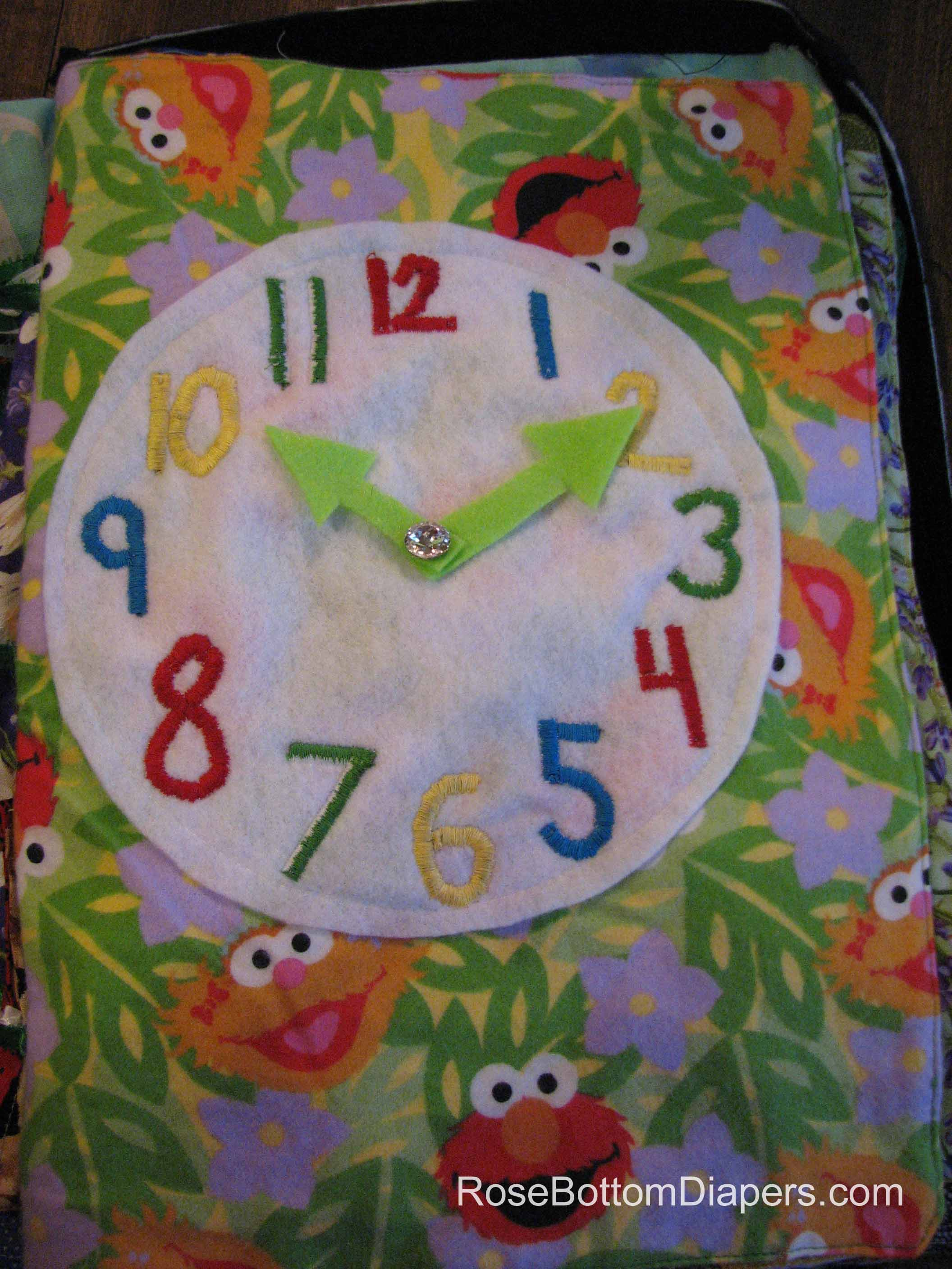 Clock quiet book page.  Learn to tell time. Busy book ideas from RoseBottomDiapers.com