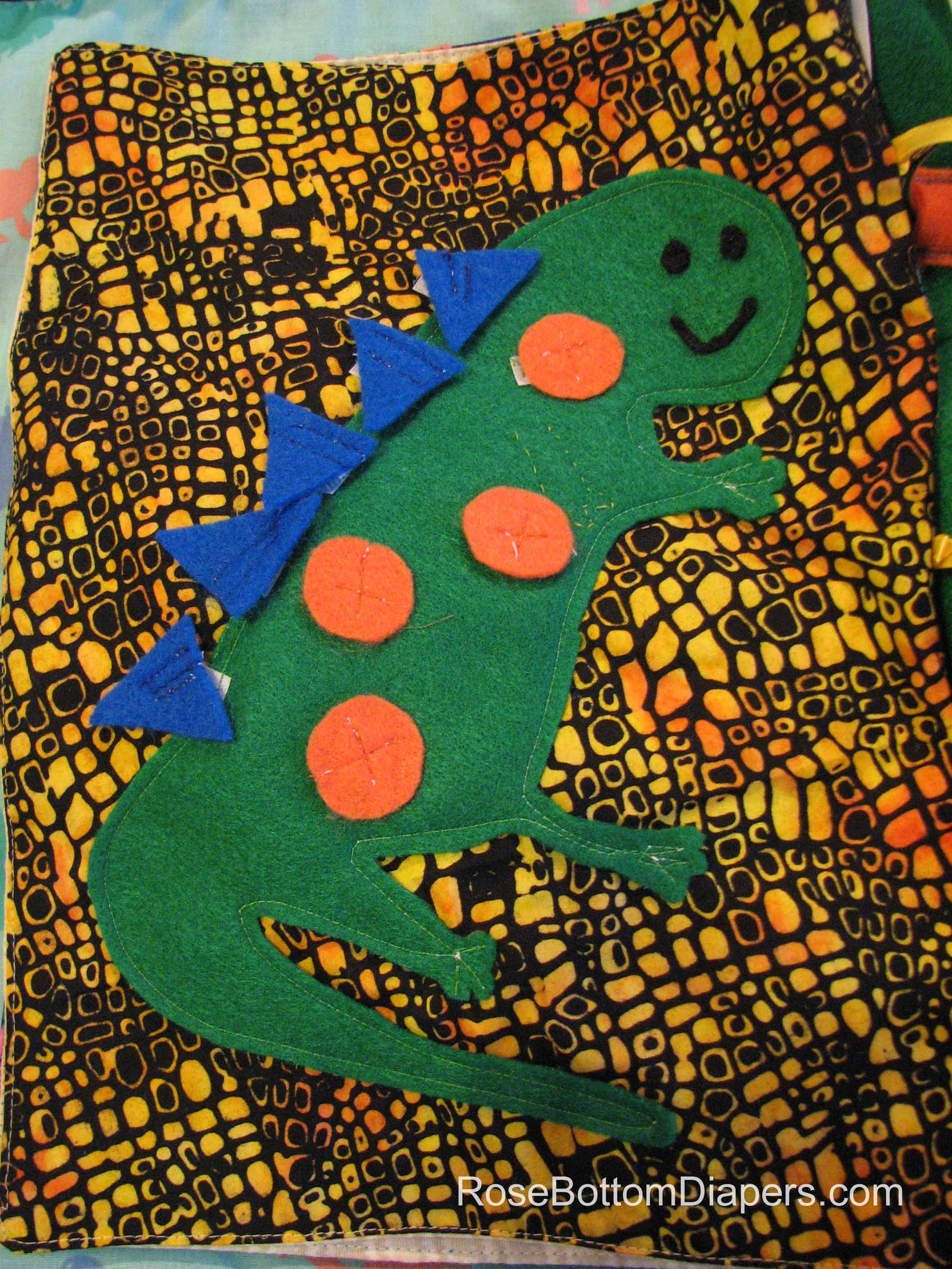 Dinosaur quiet book page. Velcro shapes on dinosaur.  Busy book ideas at RoseBottomDiapers.com