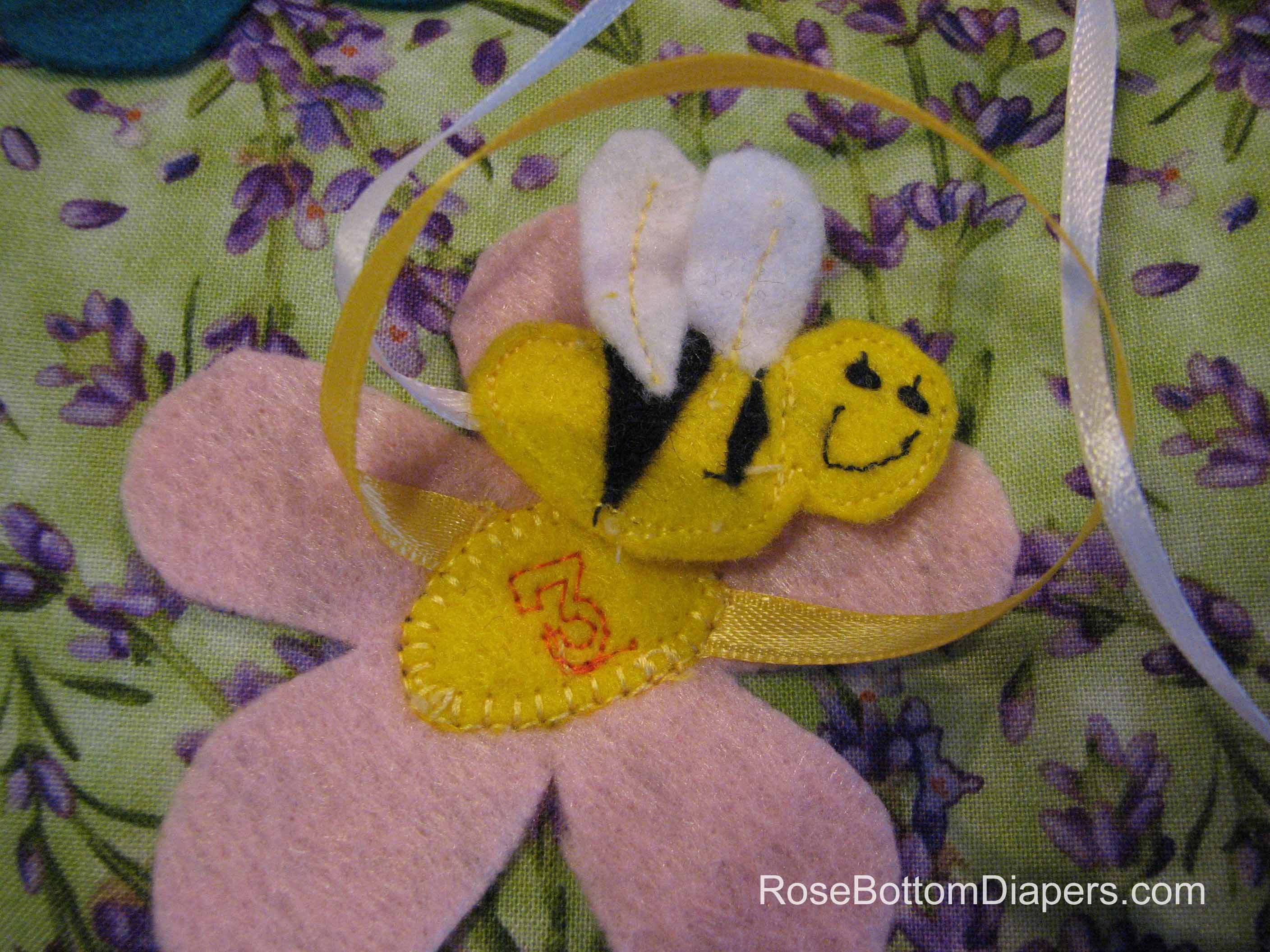 Busy Bee quiet book page.  Practice counting, number recognition, and fine motor skills.  Busy book ideas at RoseBottomDiapers.com